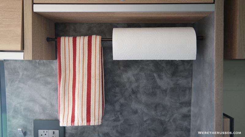 Tension rod towel holder
